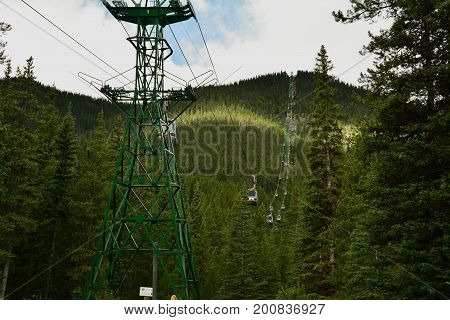 Banff Alberta Canada,July 6th 2014.The world famous gondola at Banff's Sulfur mountain is always a great site to take in.Ride the gondola to the top and experience Banff mountain vistas at every turn of ones head.