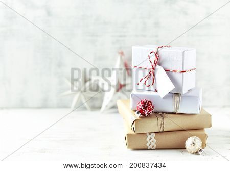 An Arrangement of Christmas Presents wrapped in gift paper in natural shades