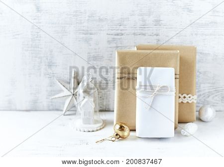 An Arrangement of Christmas Presents wrapped in gift paper in natural shades a