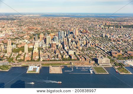 Aerial view of Brooklyn New York City with East river in the foreground