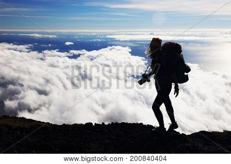 Photographer on the crater of Pico Volcano, Pico Island, Azores, Portugal, Europe