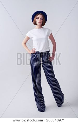 Vertical of woman with kare haircut posing in studio with copy space