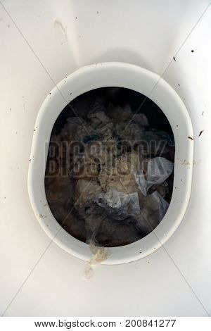 Excretory waste is contained below a toilet in an outhouse at the Black Road Access to the Rock Run Preserve in Joliet, Illinois.