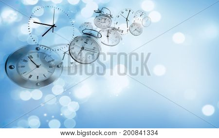 Assorted clocks on blue abstract background