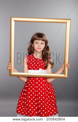 Beautiful Girl Holding An Empty Frame