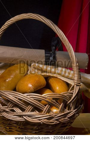 Wicker basket with fresh sintered pies on the table