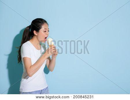 Slim Beauty Female Model Standing On Blue Wall