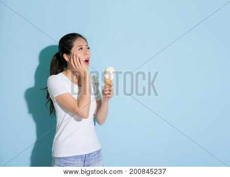 Cute Young Female Student Eating Ice Cream
