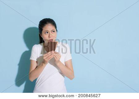 Young Elegant Woman Eating Sweet Chocolate