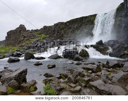 Large Waterfall With Rocks In Iceland, Europe.