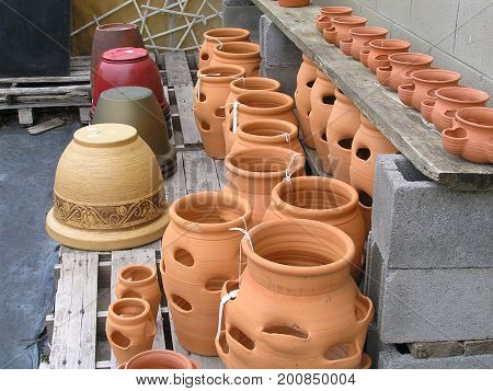 terracotta and ceramic pots and planters on benches
