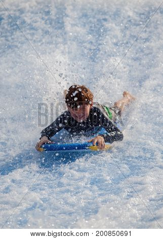 Sentosa Singapore - June 19 2010: Kid enjoy flowboarding at Wave House Sentosa