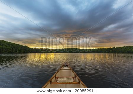 Canoe Bow On A Canadian Lake At Sunset