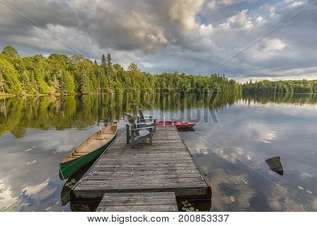 Canoe And Kayak Tied To A Dock On A Lake In Ontario Canada
