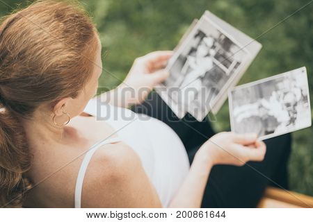 Pregnant Woman Sitting On The Bench And Loocking сhildren's Photos
