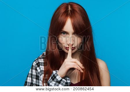 Playful young woman secrets. Gesture silent. Modern youth gossips, fashion female model, pretty lady privacy