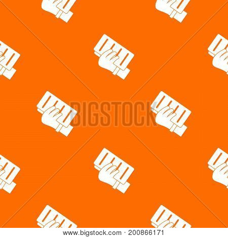 Brick in a hand pattern repeat seamless in orange color for any design. Vector geometric illustration