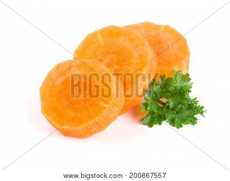 Chopped carrot slices and parsley herb leaves isolated on white background.