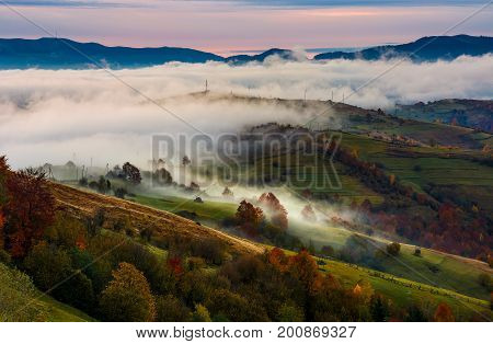 Rising Fog Covers Rural Fields In Mountains
