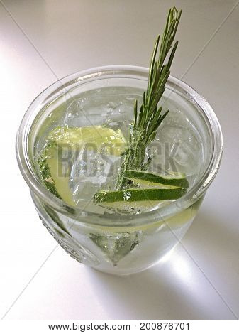 Classic Gin and Tonic cocktail with lime, lemon & rosemary