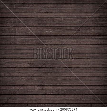 Brown wooden wall planks, table, floor surface. Dark wood texture