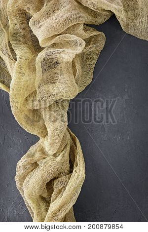Concrete Background With Khaki Gauze Fabric.