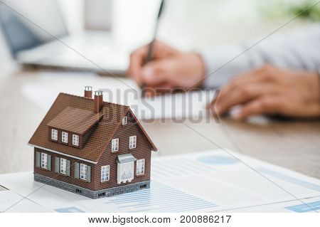 Real Estate Agent Working In His Office