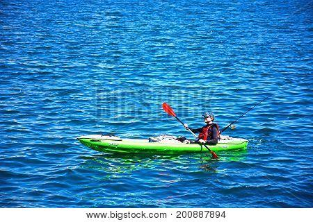 VALLETTA, MALTA - MARCH 31, 2017 - Canoeist in the Grand harbour near the Vittoriosa waterfront Valletta Malta Europe, March 31, 2017.