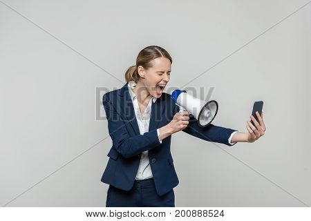 Businesswoman With Smartphone And Loudspeaker