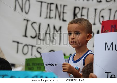 BARCELONA/SPAIN - 21 AUGUST 2017: Islamic child at the muslim community protest against terrorism in Plaza Catalunya after the attack on Ramblas a few days before.