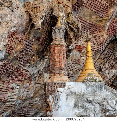 Old Buddhist Pagoda With Carvings In Kaw Goon Cave, Myanmar.