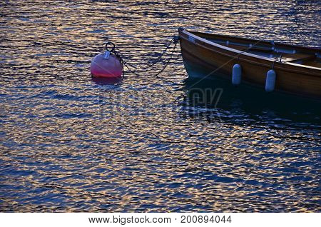 old boat in water on a buay lake garda italy