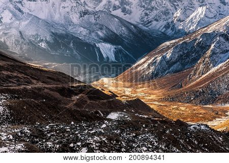 Abstract Mountain Background. Sunny Valley Among High Snowy Mountains On A Bright Sunny Day. Himalay