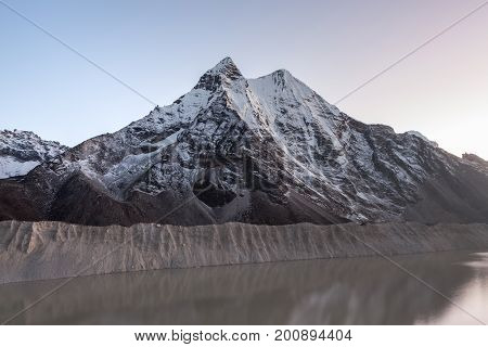 Grey Moraine Lake And Snowy Mountain Peak In The Morning Lights In Himalayas, Nepal. Mirror Water Of