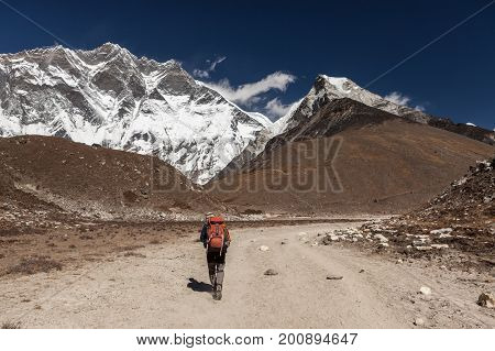 Everest Base Camp Trek/nepal - October 24, 2015: Rear View Of Woman Traveler With A Backpack Walking
