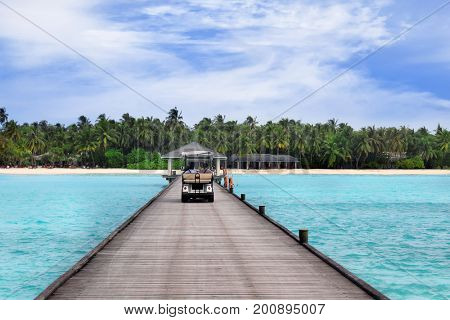 Wooden pontoon with buggy at sea resort