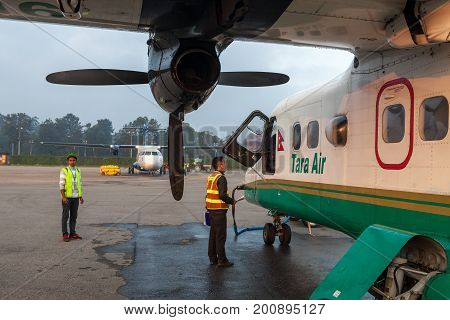 Kathmandu/nepal - October 18, 2015: Tara Air Small Plane Getting Redy For Take Off To Lukla. Ground