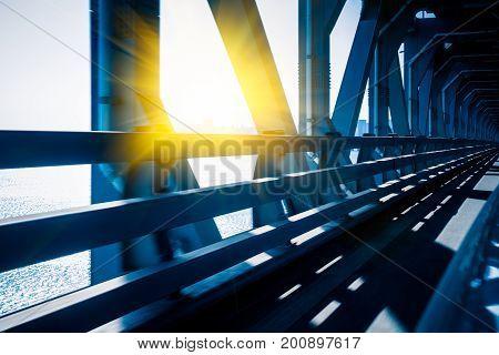 bridge handrail in a tunnelin blue tone.