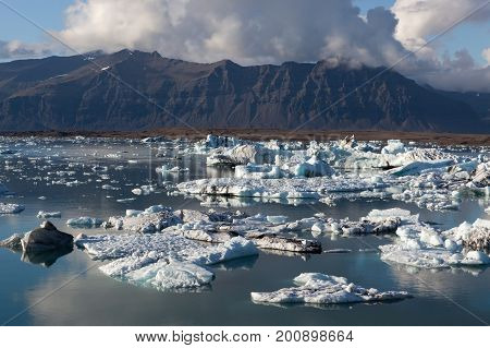 Scattered Melting Icebergs In Jokulsarlon Glacier Lagoon. Base Of The Vatnajokull Glacier At Jokulsa