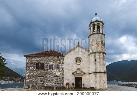 Roman Catholic Church Of Our Lady Of The Rocks  on Our Lady Of The Rocks island. One of the two islets near coast of Perast town at Kotor bay. Gospa Od Skrpeja - tourist attraction in Montenegro.