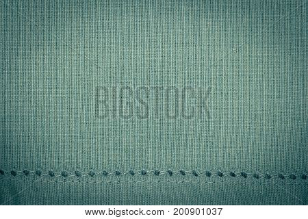 Green towel fabric. Tablecloth texture. Cotton texture closeup background