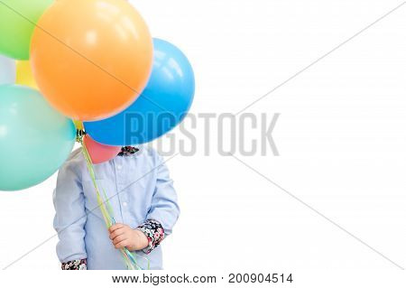 Boy hiding behind a bunch of balloons isolated on white background. Copyspace for text