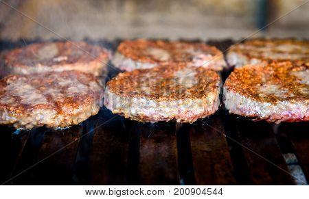 Making And Grilling Hamburger Beef Patties On Coal Grill.