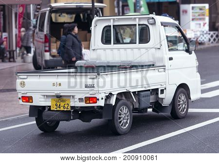 JAPAN, TOKYO, APRIL, 03, 2017 - Small commercial truck on the streets of Iwakuni, Japan.