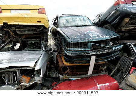 Piled crushed cars on salvage yard