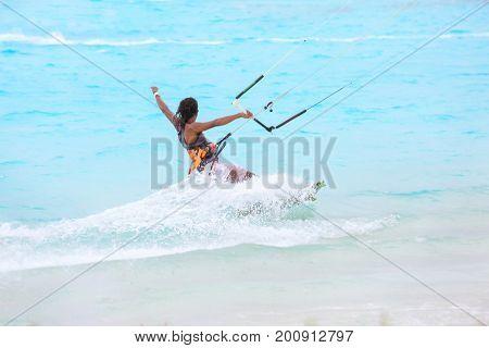 Tourist kitesurfing at sea resort