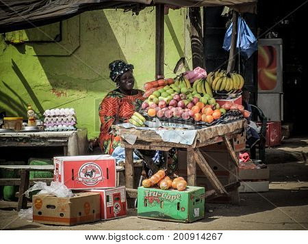 Dakar, Senegal - May 28, 2011 - The streets of the suburbs of Dakar are populated by stalls selling all kinds of food. In this image it is a woman who sells fruit in her car