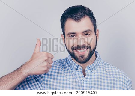 Close Up Cropped Portrait Of A Young Stylish Bearded Man In Formal Wear, Showing Thumbup Sign, Smili