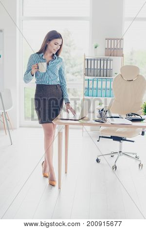 Full Length Portrait Of Successful Relaxed Lady Realtor Is Drinking Coffee At Her Work Station And I