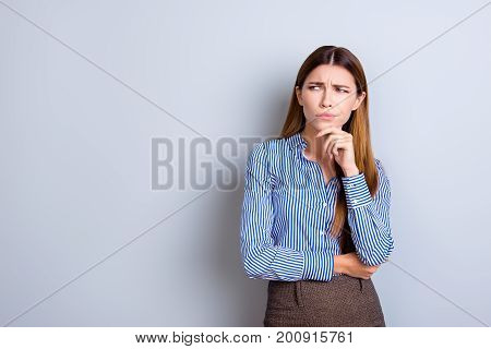 Sceptical Young Business Lady Is Unsure What To Do. She Has Focused Grimace, Wearing Strict Formal W